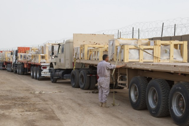 A Soldier with the Iraq Army Transportation Brigade loads repair parts for tactical and non-tactical vehicles onto Iraq Army Transportation's semi-trailer trucks near Camp Taji, Iraq, Oct. 21, 2019. For this iteration of Task Force Lincoln Divestment, Iraqi soldiers took charge of one of the largest divestments of vehicle repair parts. (U.S. Army photo by Capt. Karla M. Crayne)