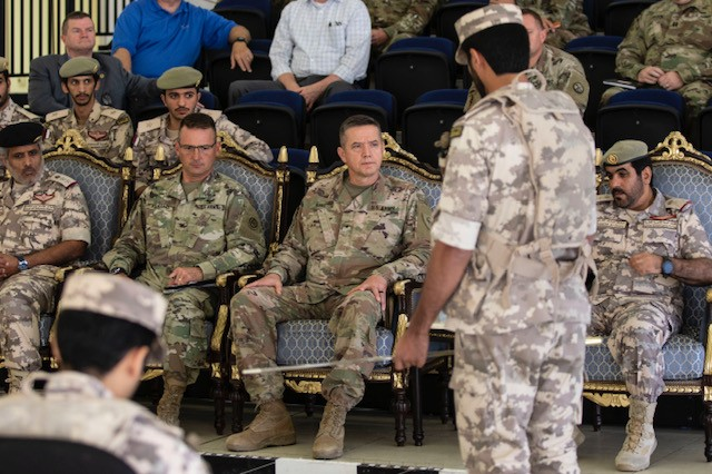 """Qatari Emiri Land Force and U.S. military leadership receive the mission brief for Eastern Action, Thursday, Oct. 31, 2019. U.S. Army Col. Steve Fabiano, the Area Support Group - Qatar commander, left center, looks at terrain map, as Brig. Gen. Steven T. King, a Task Force Spartan deputy commanding general listens to the brief. """"Working side by side presents a unique opportunity to learn from our Qatari Emiri Land Forces partners as we share our tactics, techniques and procedures with them. The interaction makes for a rich learning environment,"""" said King."""