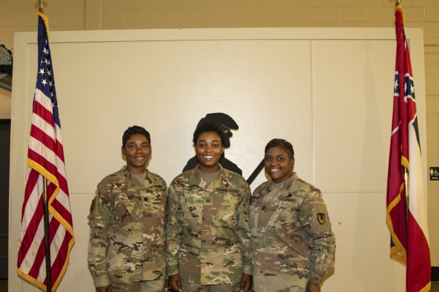 From left to right: Lieutenant Colonel Annie Lee, G4 for the 184th Sustainment Command, Sergeant Nia Davis, a Human Resources noncommissioned officer with the Higher Headquarters Command 66th Troop Command, and Brigade Command Sergeant Major for the 407th Army Field Support Brigade Stephanie Price poses for a photograph. Davis' family members Lee (mother) and Price (aunt) were in attendance for her promotion ceremony from Specialist to Sergeant.