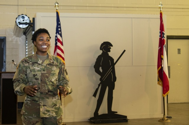 Sergeant Nia Davis, a Human Resources noncommissioned officer with the Higher Headquarters Command 66th Troop Command expresses her gratitude shortly after her promotion ceremony at the Raymond Road Readiness Center Oct. 19, 2019. She was promoted from Specialist to Sergeant.