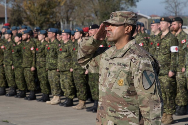1st Sgt. William Talton leads a formation of 1st Battalion, 5th Cavalry Regiment, 2nd Cavalry Division, currently serving at Mihail Kogalniceanu Air Base, Romania. U.S. Army Soldiers, joined Romanian and Canadian Forces for a Remembrance Day Ceremony, Nov. 11, 2019. Remembrance Day is a memorial day observed in Commonwealth member states recognizing the armed forces members who died in the line of duty during World War One.