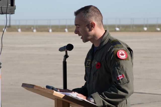 Canadian Air Force Lt. Col. Forrest Rock, Air Task Force Romania Commander, addressed the formation of U.S. Army, Romanian and Canadian Forces during a Remembrance Day Ceremony held at Mihail Kogalniceanu Air Base, Romania, Nov. 11, 2019. Remembrance Day is a memorial day observed in Commonwealth member states recognizing the armed forces members who died in the line of duty during World War One.