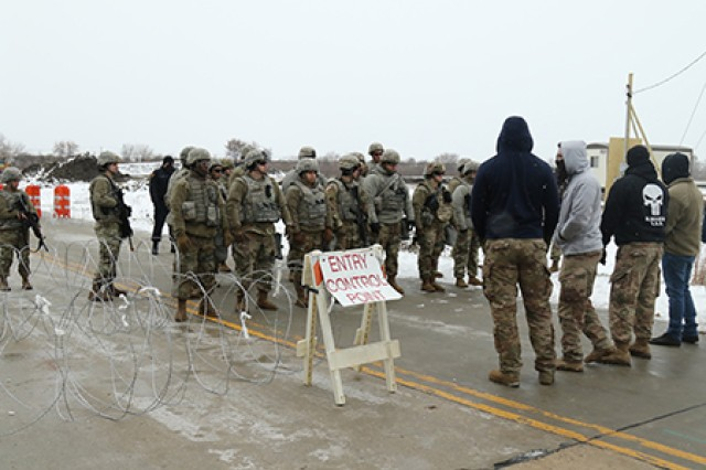 Fictional protesters confront Soldiers from the Wisconsin Army National Guard's 32nd Military Police Company at an entry control point at a power substation in Racine County Nov. 13, 2019, as part of GridEx, an exercise that tested Wisconsin's capacity to respond to a long-term mass power outage.