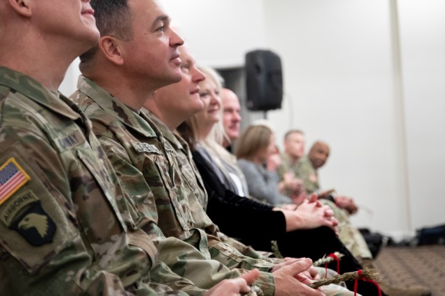 Distinguished guests hold their braids of sweet grass while listening to a speech delivered by the guest speaker Chief Black Eagle Man during the Fort Knox National American Indian Heritage Month Observance hosted by 1st Theater Sustainment Command on Fort Knox, Ky., Nov. 15, 2019. (U.S. Army photo by Bianka Lathan)