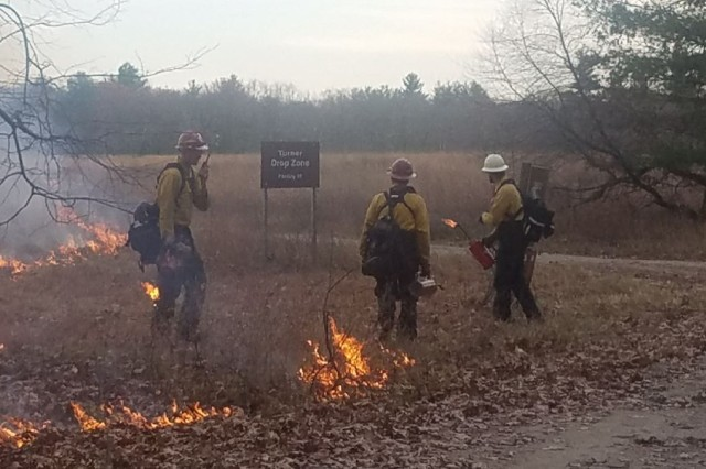 Wildland firefighters with the U.S. Forest Service ignite the holding line during the prescribed burn of Turner Drop Zone Nov. 4, 2019. Objectives of the two-day Devens Reserve Forces Training Area (Devens RFTA) project were resource and land management, conservation, and training.