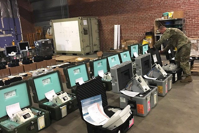 Maj. Craig Keech, chief of centralized contingency programs for the U.S. Army Medical Materiel Agency, organizes medical equipment on Oct. 18, 2019 at Sierra Army Depot, California, where units from the 531st Hospital Center from Fort Campbell, Ky., participated in an Emergency Deployment Readiness Exercise. (Photo by Maj. Bryan Pamintuan)