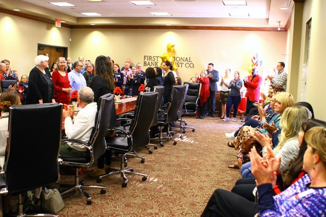 Gold Star families stand and are recognized during the highway sign unveiling Nov. 15, 2019, at the Lawton-Fort Sill Chamber of Commerce. Numerous leaders from Fort Sill, Lawton, and the state attended the dedication.