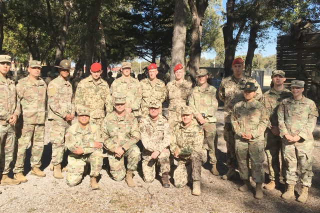 United States and German personnel gather for a group photo at the Treadwell Tower complex on Fort Sill, Oklahoma. Soldiers from the German Army visited post as part of their ongoing German Army Program for Individual Leadership of Skills.