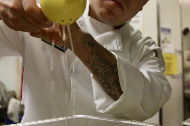 "Pfc. Luis W. Gonzalez, from 593rd Expeditionary Sustainment Command, prepares lemon juice before the dinner rush at Mercato Ristorante in Olympia, Washington, Nov. 13, 2019. ""I want to get more experience and become a chef,"" said the native of Phoenix. ""I'm just trying to learn different types of food and get experience, like in the high-end restaurants.""  Representatives from Joint Base Lewis-McChord and the restaurant partnered together to broaden the opportunities and perspectives of the base's culinary specialists."