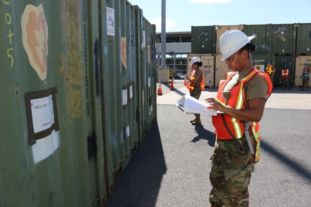 From left: Spc. Gabriela Severo, 417th ETOE documentation specialist, and Staff Sgt. Shavon Kennedy-Rios, 417th ETOE documentation NCO, write down cargo numbers after containers are offloaded from the USNS Mendonca at Pearl Harbor on Nov. 13.
