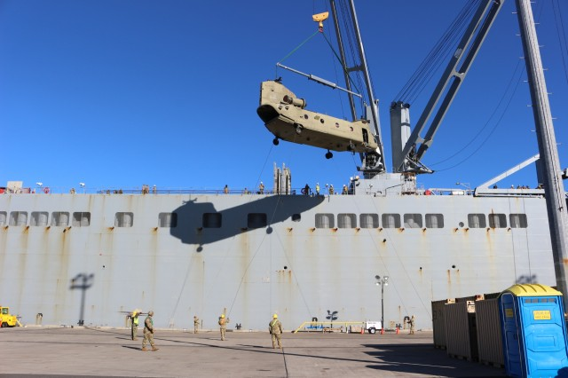 A ship's crane on the USNS Mendonca offloads a Chinook helicopter during port operations at Pearl Harbor on Nov. 13.