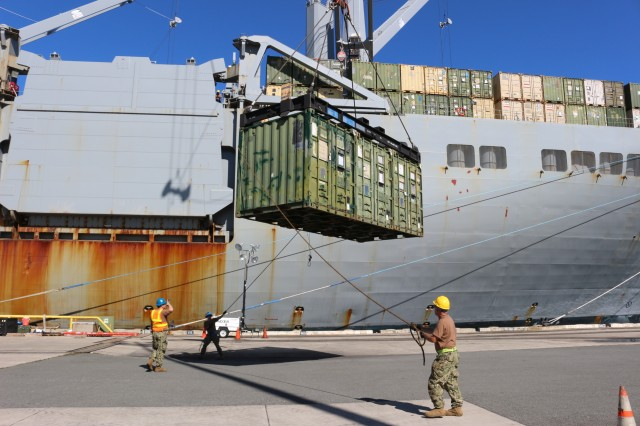 Line handlers straighten out a container as it is offloaded from the USNS Mendonca at Pearl Harbor on Nov. 13.