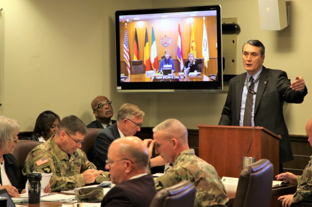 Paul Burk, director of IMCOM G9, presents financial strategies for implementing quality of life enhancements within Army Family, Morale, Welfare and Recreation during the third-quarter major subordinate command update Nov. 18 at IMCOM headquarters.