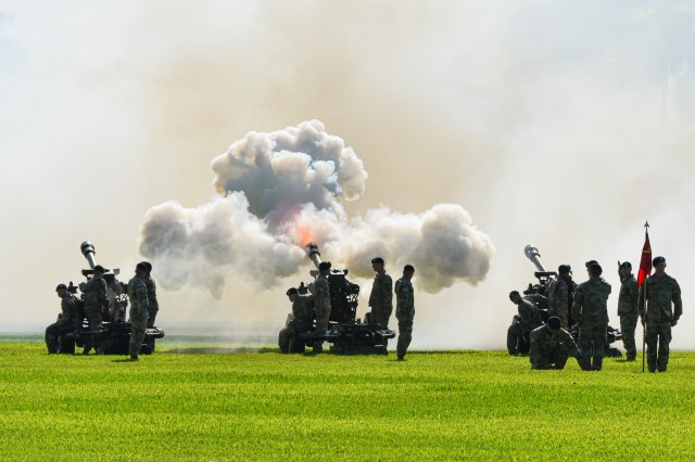 Firing Squad from the 3/7 Field Artillery, conduct the firing of the Volleys, during an assumption command ceremony, on Palm Circle, Fort Shafter, Hawaii, Nov. 18.  (U.S. Army photo by Sgt. First Class Julie Wallace Myles, USARPAC)