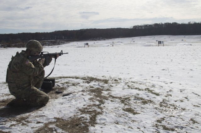 Spc. Ken Park, A Soldier with the 414th Civil Affairs Battalion engages targets during a qualification table at his unit's November drill weekend at Fort Custer, Mich. on Nov. 16th, 2019.