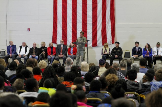 Col. Stephanie Barton, commander of the 101st Sustainment Brigade, 101st Airborne Division (Air Assault), speaks to students from local elementary schools, veterans, and Paducah community leaders during an award ceremony at the Paducah Convention Center in Paducah, Ky., Nov. 11. Soldiers of the 101st Sust. Bde. attended the Paducah Veteran's Day celebration, where Lifeliners' Soldiers and other veterans received thanks and recognition for their service. The event consisted of numerous festivities to include a breakfast, an award ceremony and a static display of various Lifeliners' military vehicles and equipment. (U.S. Army photo by Staff Sgt. Caitlyn Byrne, 101st Sustainment Brigade Public Affairs)
