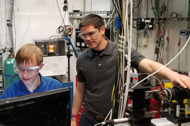 Eric Wood (left) from the University of Illinois at Urbana-Champaign and Eric Mayhew (right) from the CCDC Army Research Laboratory prepare for high-speed X-ray phase contrast imaging experiments of reacting fuel spray breakup.