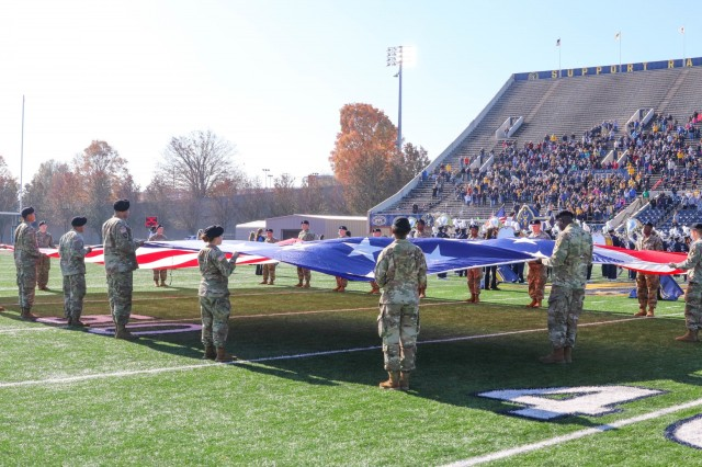 MURRAY STATE UNIVERSITY, Ky. - Soldiers of 101st Sustainment Brigade, 101st Airborne Division (Air Assault) unfurl the flag on the Murray State University football field, in Murray, Ky., as part of the Murray State University military appreciation day on Nov. 16. (U.S. Army photo by Staff Sgt. Caitlyn Byrne, 101st Sustainment Brigade Public Affairs)