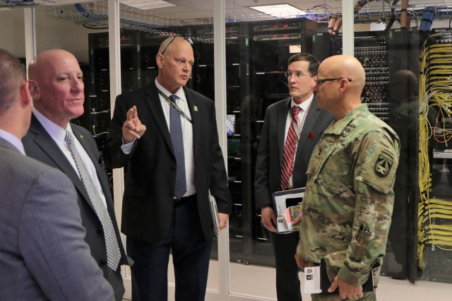 Army C5ISR Center researchers discuss their work with Maj. Gen. John A. George, commanding general of Army Combat Capabilities Development Command, at Aberdeen Proving Ground on Nov. 18, 2019.