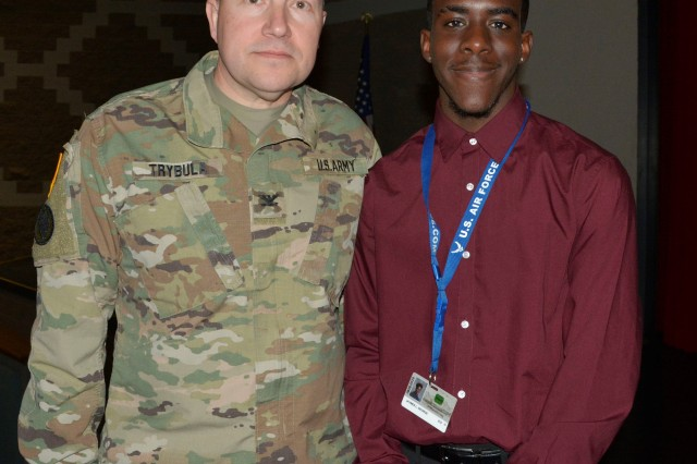 Col. David Trybula, White Sands Missile Range Commander and Jaymes George, Onate High School Student at Oñate High School on Nov. 18. The U.S. Department of Defense, in conjunction with White Sands Missile Range and the National Math and Science Initiative, partnered to bring a college readiness grant to the school.