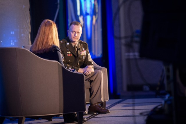 Command Sgt. Maj. William H. Rinehart, senior enlisted advisor for U.S. Army South, delivers a fireside chat Nov. 19, 2019, during the International Conference on Cyber Conflict in Arlington, Va.