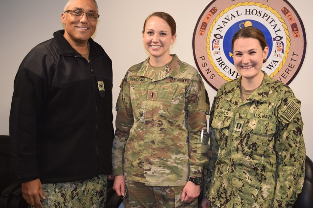 Multi service support to a Multi Service Unit...Capt. Johannes Bailey, Naval Hospital Bremerton Director for Nursing Services (L) and Lt. Kaitlyn Harmon, NHB Multi Service Unit (R), flank 1st Lt. Lauren Odegaard, from Madigan Army Medical Center, for a photo op after thanking her for her gracious assistance. Odegaard provided assistance for the entire month of October, 2019 in NHB's MSU to help with staffing shortages. During her relatively short - but helpful time - with NHB's MSU, Odegaard worked on the recovery unit where she treated over 80 patients recovering from same-day surgery (Official Navy photo by Douglas H Stutz, Naval Hospital Bremerton public affairs officer).