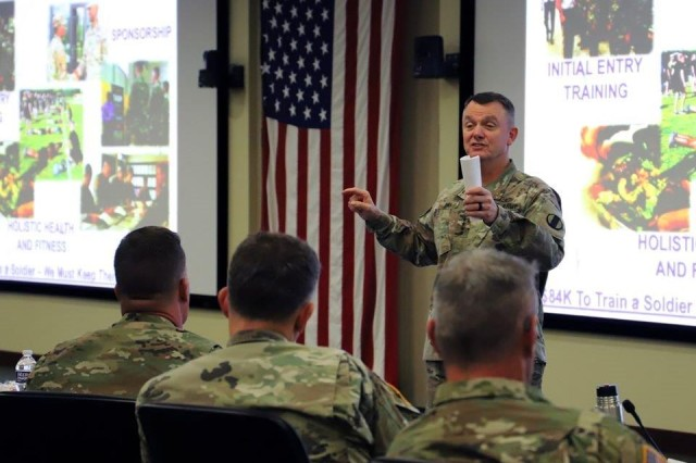 """Gen. Paul E. Funk II, commanding general, U.S. Army Training and Doctrine Command, speaks with U.S. Army #FORSCOM commanders and command sergeants major about """"unity of effort, unity of command"""" as part of the commander's forum, Nov. 14, at Fort Bragg, N.C."""