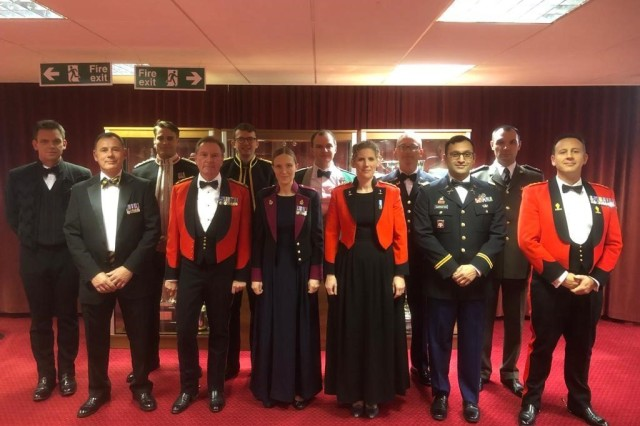 Capt. Nima Sarrafan, front row, second from right, stands with his class peers for a photo before a formal dinner as part of training at the United Kingdom Intermediate Command and Staff College in Shrivenham, England, in October 2019.