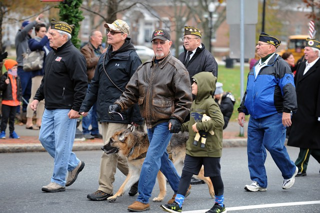 Natick veterans marching in the Veterans Day Parade on Nov. 11 included Scott Dixon with PTSD service dog, Zoey, and Bob Sinclair, marching with his grandson, William Joughin.