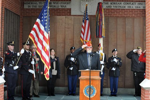 Natick Veterans Service Agent Paul Carew leads the Veterans Day program on Nov. 11 at the Morse Library.