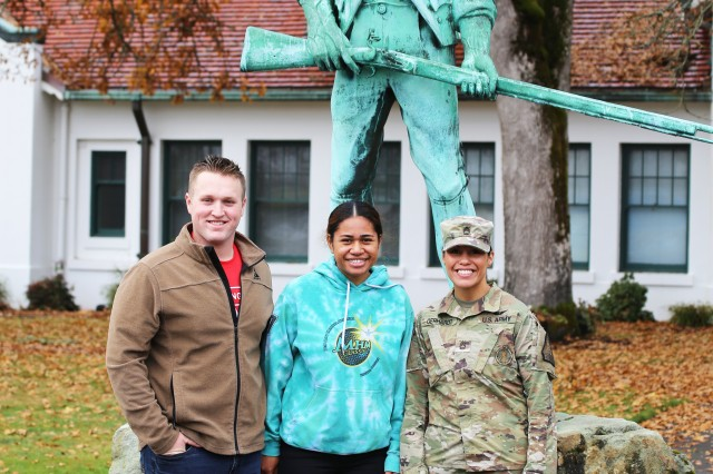 From left to right: PV2 Hunter White, PV2 April Talaiga and Staff Sgt. Marilyn Gerhardt stands with the Minuteman statue at Camp Murray Nov. 17, 2019. The couple joined the Guard together on Oct. 30, 2019.