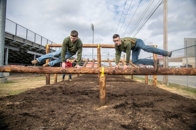 Two cadets from the Sissonville High School Marine Corps Junior Reserve Officer Training Corps (MCJROTC) demonstrate navigating an obstacle Nov. 19, 2019. Twelve engineers from the West Virginia Army National Guard completed the obstacle course project in one week in early November as a part of an Innovative Readiness Training (IRT) program.