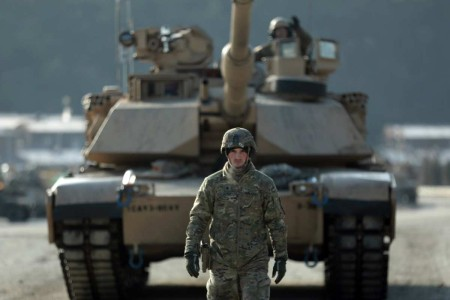 A tank crewman with 3rd Battalion, 8th Cavalry Regiment, 3rd Armored Brigade Combat Team, 1st Cavalry Division, ground guides his tank in the  Republic of Korea, Nov. 19, 2019, during the battalion's gunnery qualifications. The brigade is on a nine-month rotation in support of 2nd Infantry Division and our Korean allies.