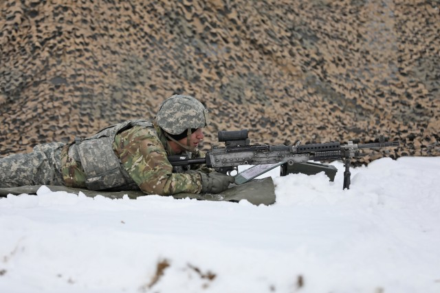 A Soldier assigned to 2nd Battalion, 15th Field Artillery Regiment, 2nd Brigade Combat Team, 10th Mountain Division, keeps an eye out for simulated enemy forces during battery level gunnery certification, November 19, 2019, at Fort Drum, New York. Allons Soldiers incorporated air assault sling load operations and simulated chemical attacks into the gunnery certification training, which will lead to battalion and brigade certification. (U.S. Army photo by Staff Sgt. Paige Behringer)
