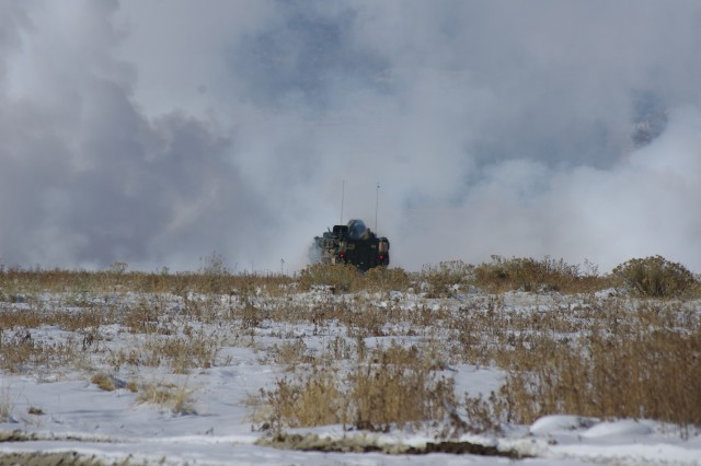 The Screen Obscuration Module (SOM) lays a plume of smoke to conceal troops maneuvering on the battlefield. Soldiers from A Troop, 2nd Squadron 1st Cavalry Regiment, 1st Stryker Brigade Combat Team, 4th Infantry Division, employed the SOM platform in multiple configurations during operational testing at Fort Carson, Colo.