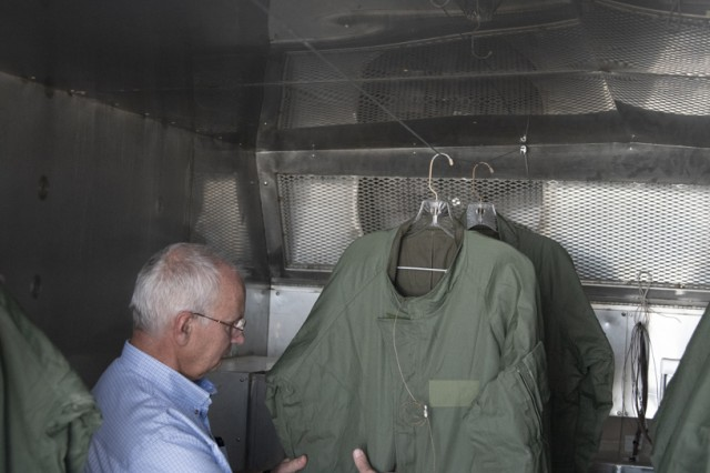 John Tobler, WDTC chemist and test officer, prepares to move Warfighter suits from the hot/humid chamber into the cold chamber for additional testing.