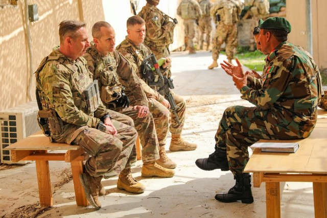 Maj. Craig Keller, Command Sgt. Maj. Matthew Marks and 1st Lt. Victor Maya of the 48th Infantry Brigade Combat Team conduct a key leader engagement with senior leaders in the Afghan National Army in Laghman Province, Afghanistan Feb. 7, 2019. The 48th Infantry Brigade Combat Team deployed to Afghanistan in support of Operation Freedom's Sentinel.