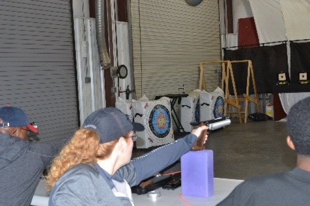 Lt. Col Rhonda Keister shoots an air pistol for the first time at Adaptive Reconditioning Camp at Fort Bragg, North Carolina, November 7, 2019. (Photo by MaryTherese Griffin)