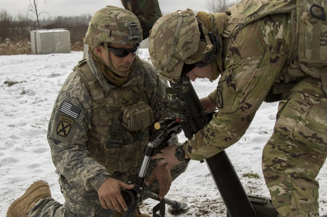 Pvt. Derek Roark, an indirect fire infantryman with Headquarters and Headquarters Company, 2nd Battalion, 87th Infantry Regiment, 2nd Brigade Combat Team, 10th Mountain Division (LI), assists in resetting the sights on an 81mm mortar system during a live-fire exercise Nov. 19, 2019 at Fort Drum, N.Y. Live-fire exercises help military units hone and perfect their skills needed for combat environments.