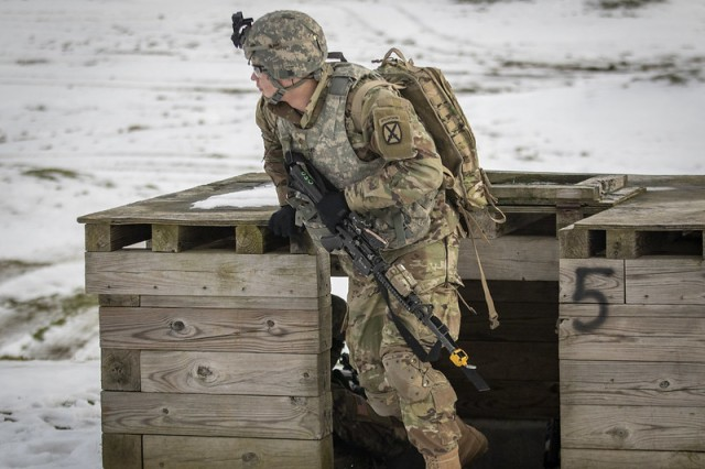 Pfc. Kendall Richardson, Headquarters Support Company, Headquarters and Headquarters Battalion, 10th Mountain Division (LI), moves towards a casualty during a live-fire exercise Nov. 18, 2019 on Fort Drum, N.Y. HHBN conducted bunker live fires and response to casualties Nov. 18-19.