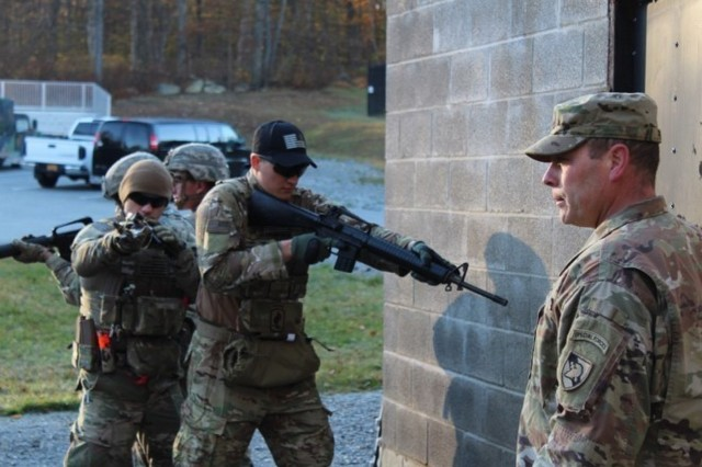 The Irregular Warfare Group and Company C-3 perform a training exercise with a joint combatives training session and Battle Drill 6 to give a foundation in close quarters combat.
