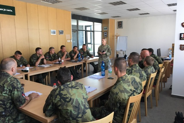 U.S. Army Sgt. 1st Class Amanda Henderson, in center, provides instruction to Czech Army students preparing to begin their Army Basic Instructor Course, at Czech Military Academy in Vyskov, Czech Republic.
