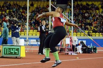 Soldier throwing javelin toward Tokyo Olympics