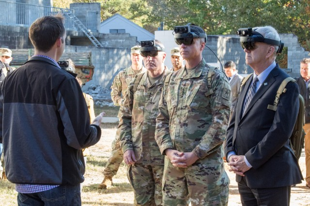 The Hon. James E. McPherson (right), the senior official performing the duties of undersecretary of the U.S. Army, Gen. John M. Murray (left), U.S. Army Futures Command's commanding general, and Gen. Joseph M. Martin (center), vice chief of staff of the U.S. Army, demonstrate a current iteration of the Integrated Visual Augmentation System, or IVAS, at Fort Pickett, near Richmond, Virginia, Nov. 6, 2019. IVAS is a next-generation situational awareness tool under development to return overmatch to Soldiers in small units throughout the close combat force.