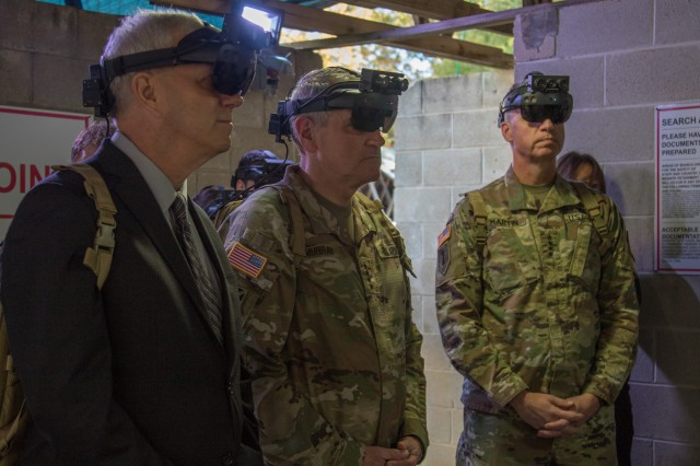 The Hon. James E. McPherson, the senior official performing the duties of undersecretary of the U.S. Army, Gen. John M. Murray, U.S. Army Futures Command's commanding general, and Gen. Joseph M. Martin, vice chief of staff of the U.S. Army, demonstrate a current iteration of the Integrated Visual Augmentation System, or IVAS, at Fort Pickett, near Richmond, Virginia, Nov. 6, 2019. IVAS is a next-generation situational awareness tool under development to return overmatch to Soldiers in small units throughout the close combat force.