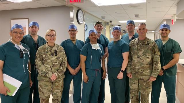 Tri-service surgeons meet the hosptial Command team
