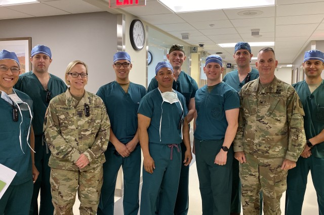 After the huddle, the Army, Navy and Air Force surgeons and Physician Assistant met with the hospital command team. (Left to Right) Col. Alfonso Alarcon, Orthopedic Surgeon at BDAACH, Maj, Harry Aubin, General Surgeon at BDAACH, Command Sgt. Maj. Nicole Haines, the hospital senior enlisted advisor, Capt. Christopher Ng, Air Force General Surgeon with 51st MDG, Maj. Eric de la Cruz, Chief of General Surgery at BDAACH, LCDR Paul Lewis and LCDR Dan Sanford, General Surgeons with 3rd Medical Battalion, Navy, Maj. John Fletcher, General Surgeon at BDAACH, Col. Andrew L. Landers, Hospital Commander, and Capt. Steven Maya, Air Force Physician Assistant with 51st MDG.