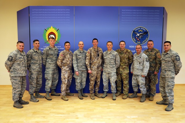 Members of the Michigan Air National Guard and the Latvian Air Force pose Nov. 15, 2019, after a planning meeting at Lielv�rde Air Base, Latvia, to chart cooperation under the National Guard Bureau's State Partnership Program.