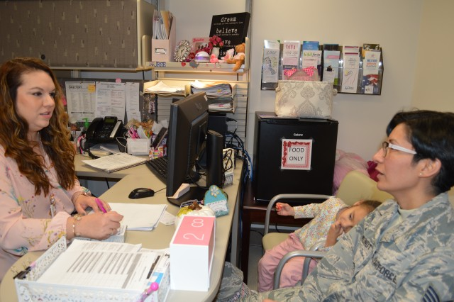 Bianca Rodriguez (left), a breast nurse navigator at Brooke Army Medical Center, talk with breast cancer survivor Air Force Staff Sgt. Desiree Mora Mundt Oct. 31, 2019. As a breast nurse navigator, Rodriguez serves as an advocate for her patients, arranging surgery, acting as a go-between for the patient and their provider, and even coordinating transportation to and from appointments.