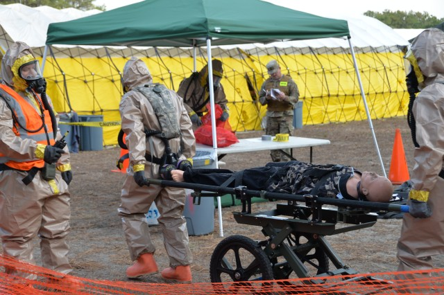 New York Army National Guard Soldiers of the Homeland Response Force for FEMA Region 2 move a simulated casualty to decontamination during an exercise for chemical, biological, radiological or nuclear (CBRN) incident response training at Lakehurst Naval Air Station at Joint Base McGuire Dix Lakehurst in Lakehurst, N.J. November 15, 2019. Decontamination team members are assigned to the 642nd Support Battalion and cross-trained for the CBRN response skills needed for decontamination. More than 600 Soldiers and Airmen of the New York and New Jersey National Guard participated in the training to prepare for the task force capabilities to conduct casualty evacuation, decontamination and medical triage under CBRN conditions.